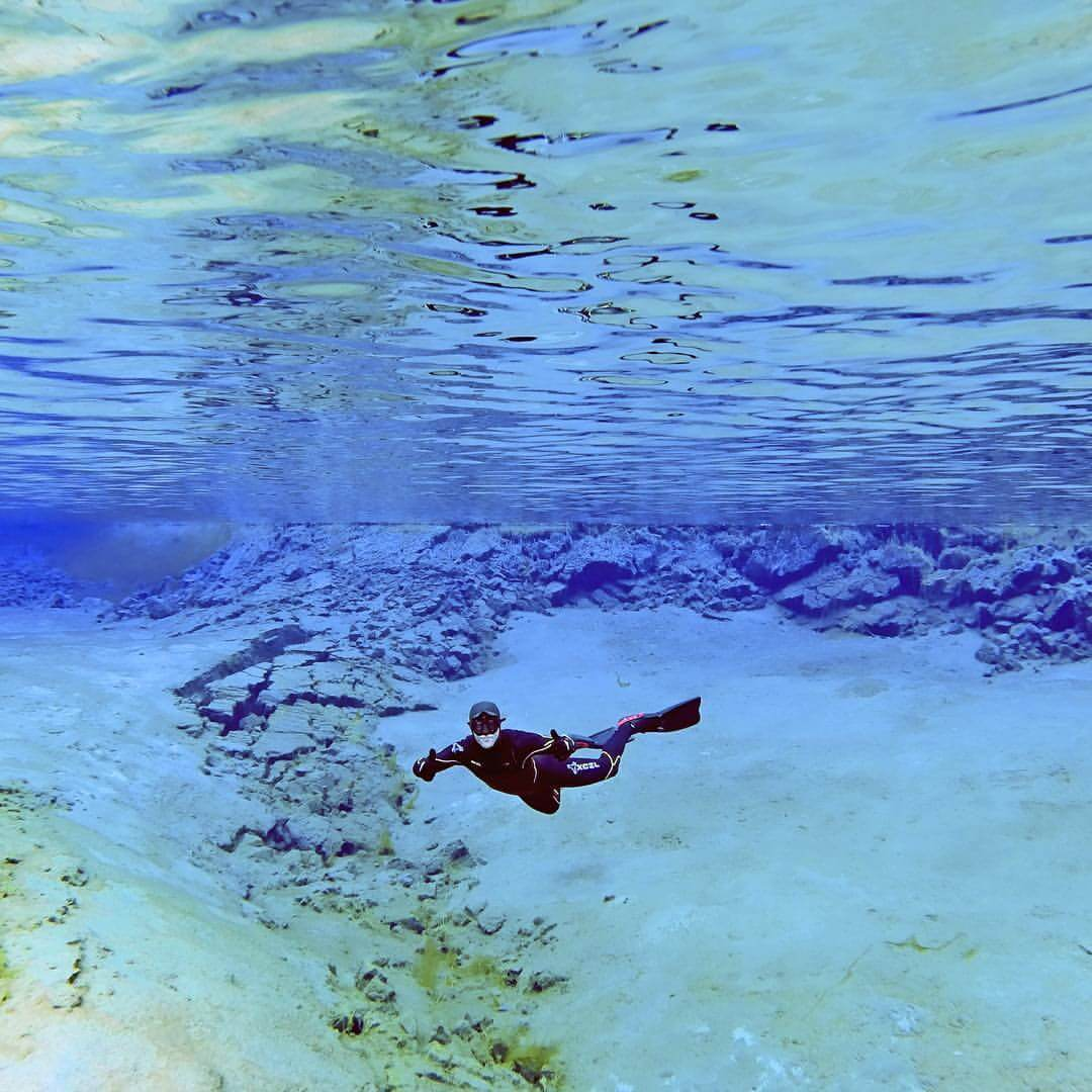 Freediving in cristal clear glacier water Silfra